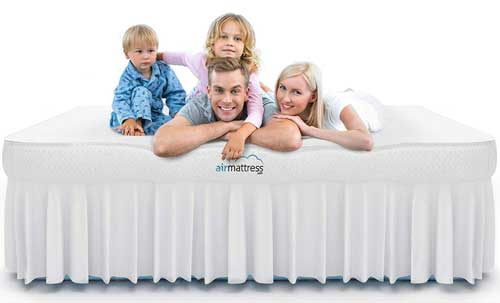 family laying on a king size airbed