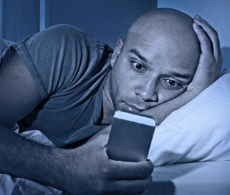 man waking up to read a message on phone