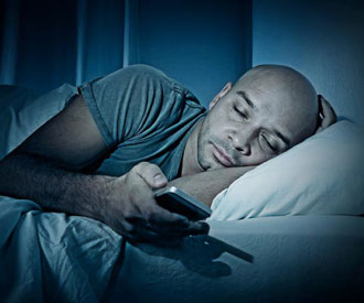 tired man falling asleep with phone